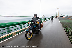 Frank Westfall riding his 1930 Henderson KJ through the rain during the Cross Country Chase motorcycle endurance run from Sault Sainte Marie, MI to Key West, FL. (for vintage bikes from 1930-1948). Stage 1 from Sault Sainte Marie to Ludington, MI USA. Friday, September 6, 2019. Photography ©2019 Michael Lichter.