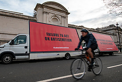 © Licensed to London News Pictures. 17/04/2018. London, UK. Three mobile billboards are driven around Westminster to protest against alleged antisemitism in the Labour Party. Photo credit: Rob Pinney/LNP
