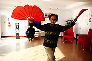 A resident practices fan dancing at the Cherish-Yearn retirement community on the outskirts of Shanghai, China, on Tuesday, Dec. 13, 2011. China has about  36000 institutions and 2.7 million beds serving the elderly, enough for 1.6 percent of the population over 60, according to the World Bank.