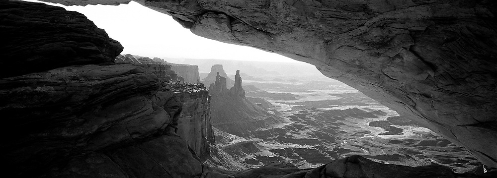 Wide arch angle rock opening with Canyonlands view
