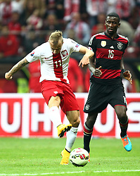11.10.2014, National Stadium, Warsaw, POL, UEFA Euro Qualifikation, Polen vs Deutschland, Gruppe D, im Bild KAMIL GROSICKI POLSKA ANTONIO RUDIGER ( GERMANY ) // KAMIL GROSICKI POLSKA ANTONIO RUDIGER ( GERMANY ) // during the UEFA EURO 2016 Qualifier group D match between Poland and Germany at the National Stadium in Warsaw, Poland on 2014/10/11. EXPA Pictures © 2014, PhotoCredit: EXPA/ Newspix/ Michal Nowak<br /> <br /> *****ATTENTION - for AUT, SLO, CRO, SRB, BIH, MAZ, TUR, SUI, SWE only*****