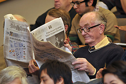 Audience members patiently waiting for the program to begin with newspapers. Robert B. Zoellick, president, World Bank, interview by Ernesto Zedillo, director, Yale Center for the Study of Globalization. Luce Center, Yale University, New Haven, CT