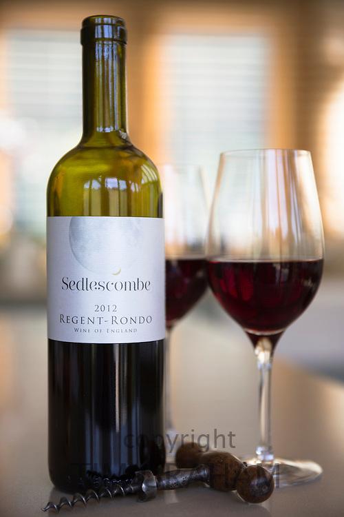 English wine - Bottle of Sedlescombe red wine Regent Rondo, poured in glasses with corkscrew from Sedlescombe Vineyard in Kent, UK