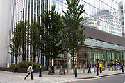 Street scene at the base of 20 Fenchurch Street in the City of London, England, United Kingdom. 20 Fenchurch Street is a commercial skyscraper in London that takes its name from its address on Fenchurch Street, in the historic City of London financial district. It has been nicknamed The Walkie Talkie because of its distinctive shape. Construction was completed in spring 2014, and the top-floor sky garden was opened in January 2015. The 34-storey building is 160 m 525 ft tall, making it the sixth-tallest building in the City of London and the 12th tallest in London, England, United Kingdom.