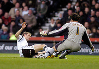 Photo: Leigh Quinnell.<br /> Derby County v Plymouth Argyle. Coca Cola Championship. 30/12/2006. Plymouth goalkeeper Romain Larrieu stops Derbys Morten Bisgaard.