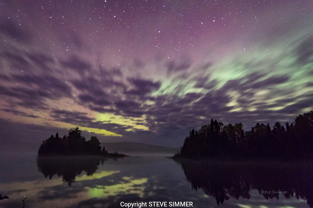 On Two Island Lake in the Superior National Forest, clouds and the Aurora joined up to create a striking scene.