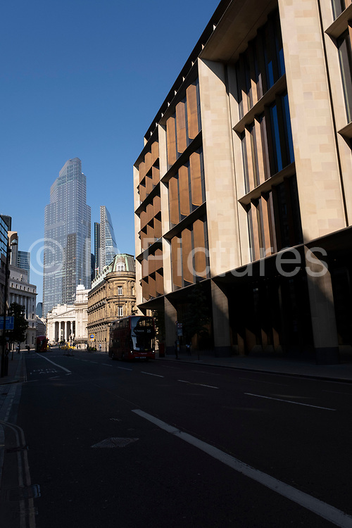 Streets in the City of London remain incredibly quiet apart from a few vehicles and people under Coronavirus lockdown on 25th June 2020 in London, England, United Kingdom. As the July deadline approaces and government will relax its lockdown rules further, the West End remains quiet, while some non-essential shops are allowed to open with individual shops setting up social distancing systems.