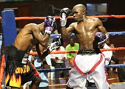 Gabriel Ochieng (R) of Kenya gives Juma Fundi of Tanzania a TKO win in the Super Feather weight during their Mac Series Professional Boxing Bonaza at Safaricom Indoor Arena in Nairobi on November 5, 2016. Gabriel won. Photo/Fredrick Onyango/www.pic-centre.com (KEN)