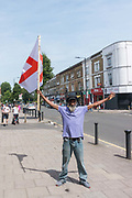 Ahead of Englands 6 1 win against Panama, Brixton local, Des waves the St Georges flag on Tulse Hill on the 24th June 2018 in Brixton in the United Kingdom.