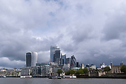 A cityscape that overlooks the river Thames showing the skyline of the City of London, the capital's financial district, on 24th May 2021, in London, England.