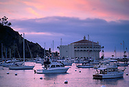 Sunset over the Casino Building and boats in Avalon Harbor, Catalina Island, California