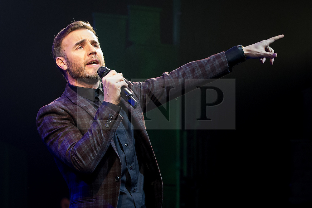 """© Licensed to London News Pictures . 12/01/2016 . Salford , UK . GARY BARLOW makes a surprise appearance and performs in front of the audience at the Lowry Theatre , during the opening week of """" The Girls """" , a musical he wrote based on the story """" Calendar Girls """" , about a group of Women's Institute members in Yorkshire , who made a nude calendar . Photo credit : Joel Goodman/LNP"""