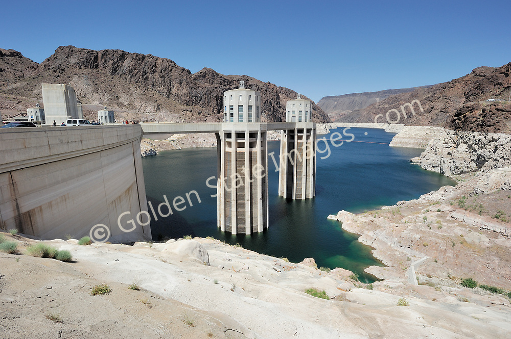 Lake Mead intake towers at Hoover Dam.<br /> <br /> Hoover Dam is designed to never have the water level of Lake Mead overtop the dam. There are spillways on each side which route excess storage around the dam.