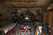 The bedroom of 58 year old Qiao Jingchao and wife Tan Minquan, in Maijieping Village, near Dengfeng, Henan Province, China on 23 October,  2013. Once the home to some 200 people, the village of Maijieping has seen its numbers dwindled to only four permanent  residents as most have moved to more convenient locations with access to jobs, schools, and hospitals.