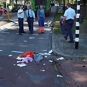 Ongeval Crailoseweg - Naarderstraat Huizen, kind onder vuilniswagen