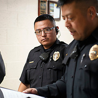 Gallup Police Officer Patrick Largo is presented with a Life Saving Award and a Citation for Commendation by Sergeant Mark Spencer, Tuesday, August 28, 2018 at the Gallup Police Department for helping a suicidal person.