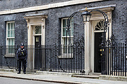 A police officer guard the entrance of 10 Downing Street in London, as the death toll from coronavirus in the UK reached 71 people, with 1,950 confirmed positive.  Wednesday, March 18, 2020. (Photo/Vudi Xhymshiti)