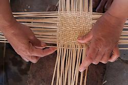 Asia, Laos, Luang Prabang, Straw hatmaker at work