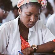 INDIVIDUAL(S) PHOTOGRAPHED: Menry Berijarnen. LOCATION: University of the Artistide Foundation (UNIFA), Tabarre Commune, Port-au-Prince, Haïti. CAPTION: Menry Berijarnen, a medical student from the University of the Artistide Foundation (UNIFA), completes a questionnaire as part of training.