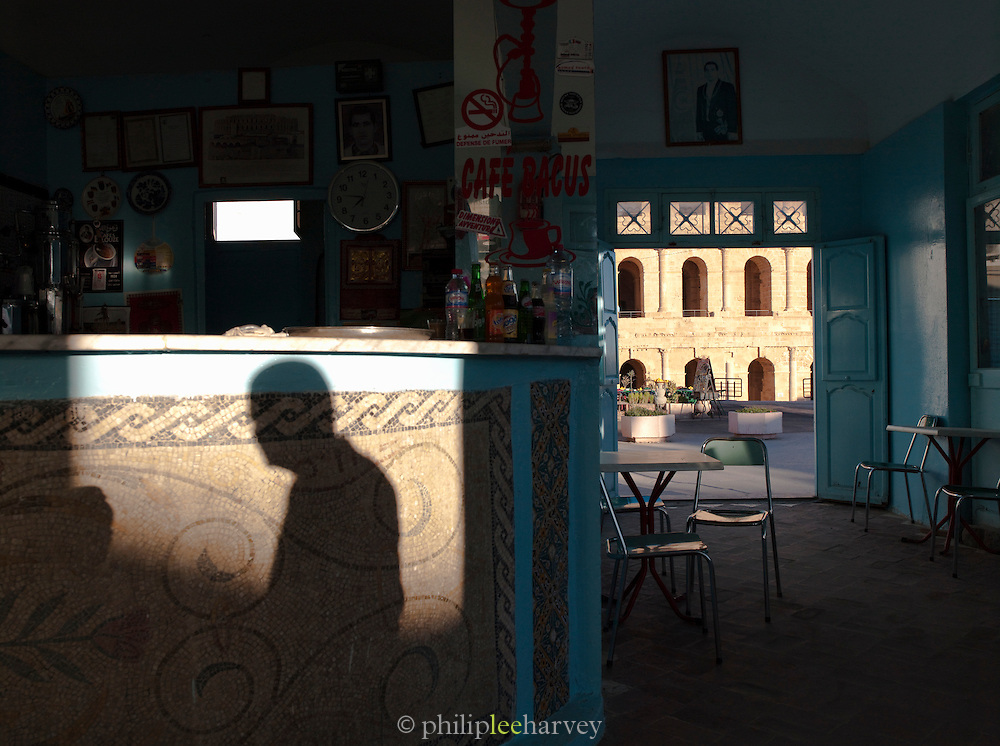 Cafe bar interior overlooking Roman amphitheatre, El Djem, Tunisia