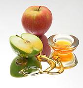 Apples and Honey, Symbols of Rosh Hashanah the Jewish New Year on white background