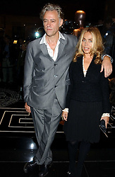 SIR BOB GELDOF and MISS JEANNE MARINE at a party hosted by Versace during London Fashion Week 2005 at their store in Slaone Street, London on 19th September 2005.<br />
