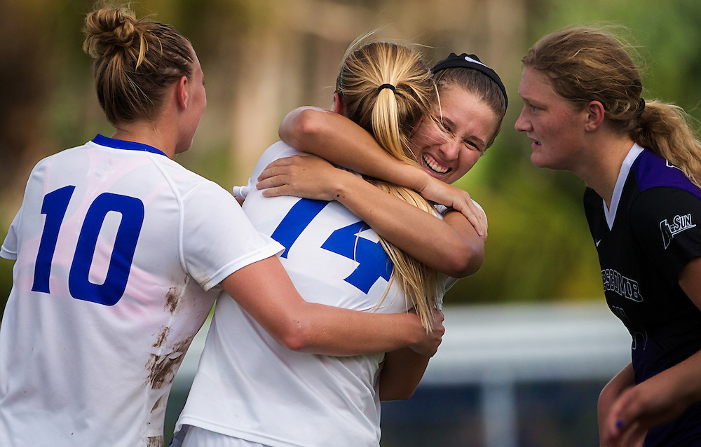 Florida Gulf Coast University's Tabby Tindell, center right, celebrates teammate Sarah Lowicki's goal against Lipscomp in the second half on Sunday, Nov. 8, 2015, in Fort Myers. FGCU defeated Lipscomb, 5-0, to clinch the Atlantic Sun Conference championship in women's soccer.