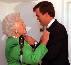 Former first lady Barbara Bush, wife of former President George H.W. Bush and mother of former President George W. Bush, died Tuesday at her home in Houston. She was 92. Barbara Bush had been in failing health, suffering from congestive heart failure and chronic obstructive pulmonary disease. George and Barbara, who celebrated their 73rd wedding anniversary on Jan. 6, hold the record for the longest-married presidential pair. Mrs. Bush was known for her wit and emphasis on family. One of her primary causes was literacy. She founded the Barbara Bush Foundation for Family Literacy in 1989 to carry forth her legacy in the cause for literacy. PICTURED: Sept. 28, 1994 - Coral Gables, Florida, U.S. - BARBARA BUSH pins her pin on son JEB and he pins her with his at a breakfast fundraiser that she was the featured speaker at to help son Jeb in his campaign on Sept. 28, 1994 at the private home of Sergio Pino in Coral Gables, Fla. (Credit Image: © Marice Cohn Bandl/TNS/ZUMA Wire)