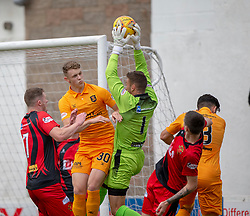 Livingston Jack Hamilton and Annan Athletic's keeper Alex Mitchell. half time : Livingston 1 v 0 Annan Athletic, Scottish League Cup Group F, played 21/7/2018 at Prestonfield, Linlithgow.