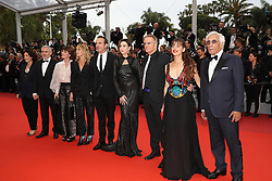 """Audrey Dana, Christophe Lambert, Gerard Darmon, Elsa Zylberstein, Jean Dujardin, Mathilde Seigner,Irene Jacob and French director Stephane Brize and a guest attend the screening of """"Les Plus Belles Annees D'Une Vie"""" during the 72nd annual Cannes Film Festival on May 18, 2019 in Cannes, France. Photo by Shootpix/ABACAPRESS.COM"""
