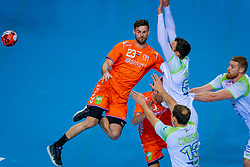 The Dutch handball player Jorn Smits in action against Borut Mackovsek from Slovenia during the European Championship qualifying match on January 6, 2020 in Topsportcentrum Almere