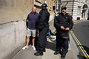 Police arrest a Free Tommy Robinson demonstrator for throwing a smoke flare, on 24th August 2019 in London, United Kingdom. Some 250 Stand Up To Racism and other anti-fascist groups took to the streets today in opposition to supporters of jailed 'Tommy Robinson' real name Stephen Yaxley-Lennon at Oxford Circus, who gathered outside the BBC.