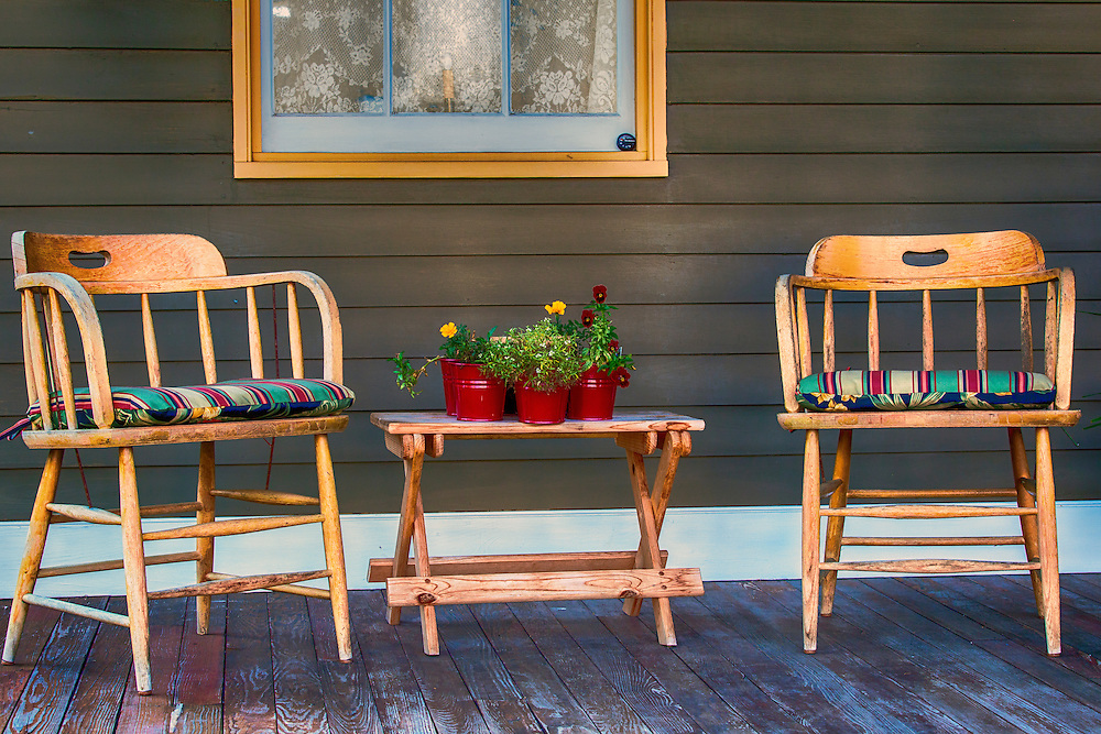 A couple of chairs to relax in, on an old front porch. A sense of zen and relaxation on a quaint New Melle, Missouri front porch.
