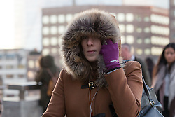 © Licensed to London News Pictures. 29/11/2016. LONDON, UK. A woman walks across London Bridge during cold weather this morning, following what has been one of the coldest night of this winter so far in the capital.  Photo credit: Vickie Flores/LNP