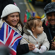 London, England, UK. 9th January 2018. A child holding a Union flag during Prince Harry and Meghan visit Reprezent 107.3FM Radio station.