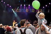 Free Use of Picture<br /> 7 September 2013: Young child with a balloon today at Hull's Freedom Festival,  the biggest street festival in the north of England,  which started on Friday night and ends tomorrow night (Sunday) and will attrcat over 100,000 people.<br /> <br /> Extra info: UK City of Culture 2017 candidate city Hull tonight hosted a spectacular torchlight procession featuring almost 1000 local residents as part of the opening ceremony of Freedom Festival, the city's major annual cultural showcase.<br /> The main procession of flaming torchbearers began at the city's statue of Hull MP William Wilberforce, through the cobbled streets of the city's old town and culminated in a stunning recital of Martin Luther King's 'I Have a  Dream' speech by renowned author and poet Lemn Sissay MBE, 50 years on from when the pivotal address was made.<br /> Freedom Festival grew out of bicentenary commemorations in Hull in 2007 of William Wilberforce's Act of Parliament, which abolished the slave trade in the British Empire.<br /> This is the sixth annual Freedom Festival, which celebrates, through artistic and cultural expression, Hull's independent spirit and historic contribution to the cause of freedom as the birthplace of MP William Wilberforce. Acts appearing during the weekend include The 1975, French theatre pioneers Transe Express in a UK exclusive, Tanzanian acrobatic troupe The Black Eagles and much more.<br /> Free use of picture<br /> Picture: Sean Spencer/Hull News & Pictures Ltd<br /> 01482 772651/07976 433960<br /> www.hullnews.co.uk   sean@hullnews.co.uk