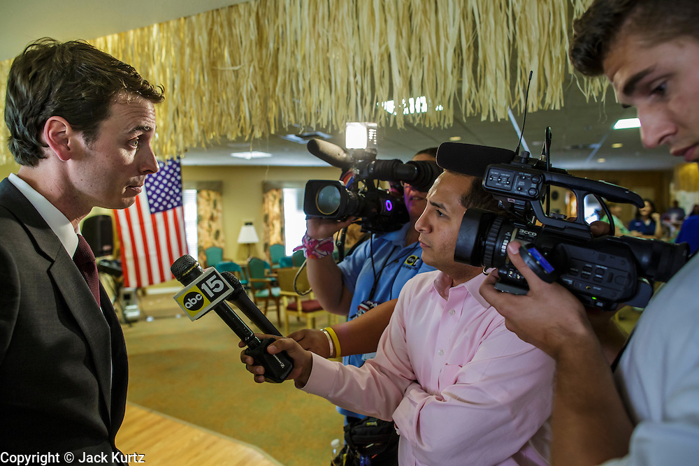 09 AUGUST 2012 - SCOTTSDALE, AZ:  Congressman BEN QUAYLE (R-AZ) talks to reporters after a candidate forum at an adult assisted living facility in Scottsdale, AZ, Thursday. Republican Congressmen Ben Quayle and David Schweikert are facing each other in Arizona's Aug. 28 Republican primary. They are vying for the right to represent Arizona's 6th Congressional District. Both men are incumbent freshmen Congressmen. They were thrown into the same district during the redistricting process after the 2010 census. Both men are conservatives courting the Tea Party vote.   PHOTO BY JACK KURTZ