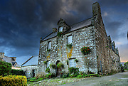 Postcard picture of a Beautiful old house of the village of Locronan, located in Finistere, Brittany, France after the morning showers in winter