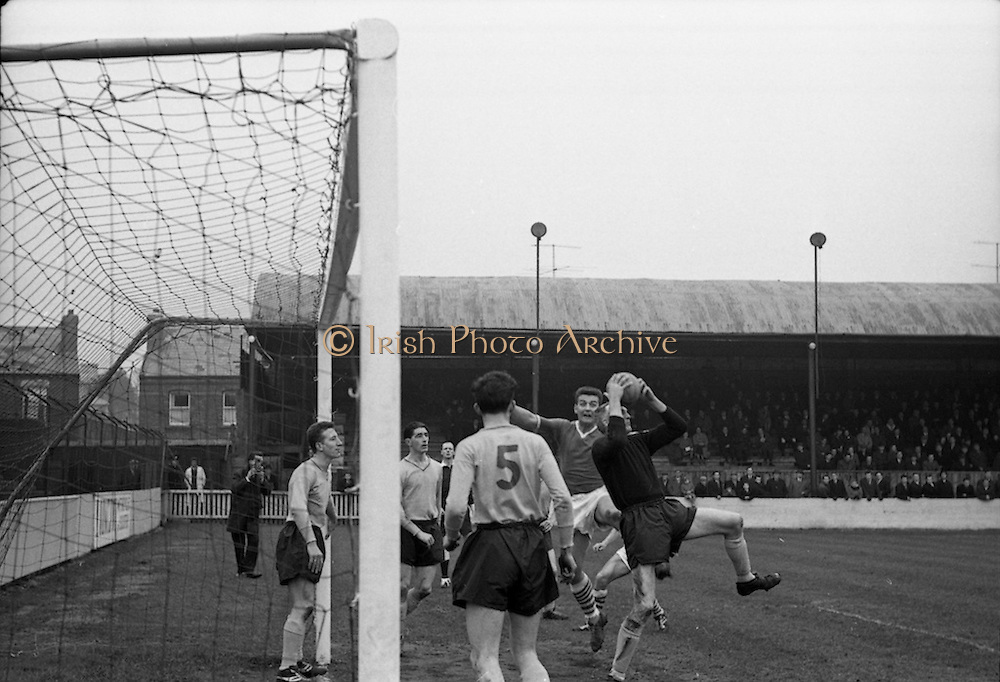 16/02/1964<br /> 02/16/1964<br /> 16 February 1964<br /> Soccer: Cork Hibernians v Drumcondra, 1st round of the F.A.I. Cup at Tolka Park, Dublin. Drums goalie Eamonn Darcy rushes out to grasp the ball from the path of one of the Cork Hibs. forwards.