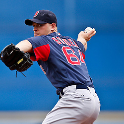 March 6, 2011; Port St. Lucie, FL, USA; Boston Red Sox relief pitcher Michael Bowden (64) during a spring training exhibition game against the New York Mets at Digital Domain Park.  Mandatory Credit: Derick E. Hingle