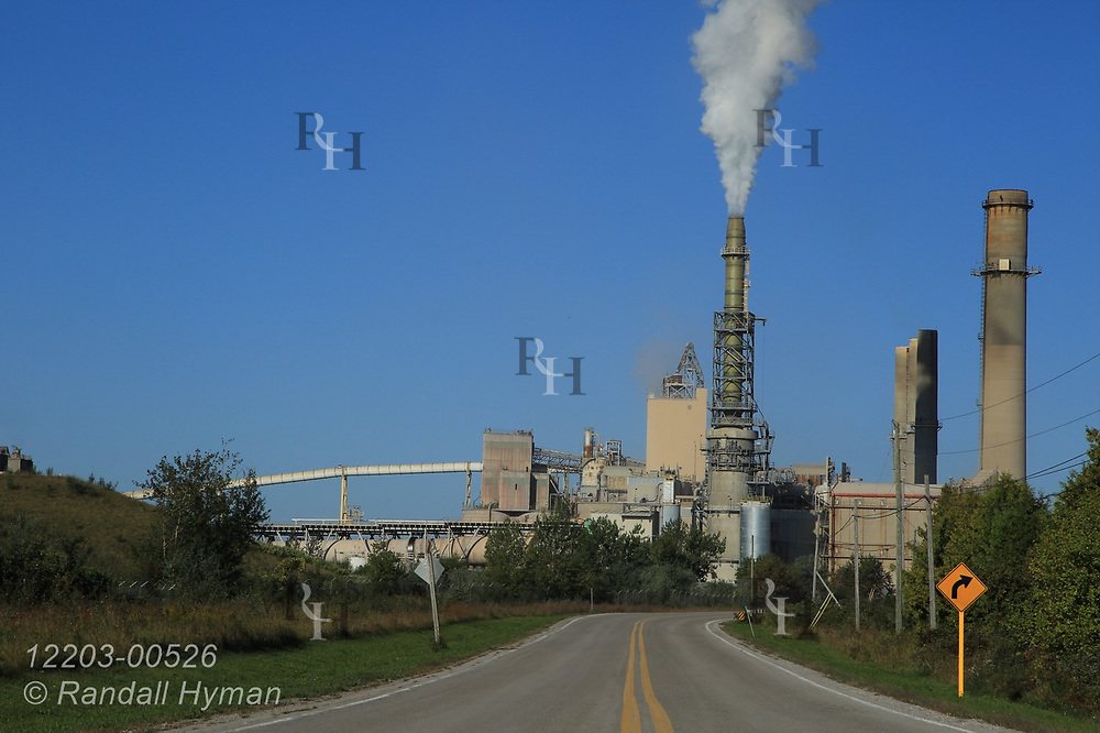Smokestack pours carbon dioxide into air at Lafarge Cement Plant; Alpena, Michigan.