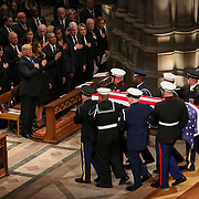 Former President George H.W. Bush is carried out of the National Cathedral in Washington, D.C., after his state funeral on Wednesday, December 5, 2018. Bush died on Nov. 30th at the age of 94 after a long battle with vascular parkinsonism.