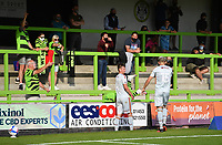 Football - 2020 / 2021 EFL League Two - Forest Green Rovers vs Bradford City<br /> <br /> Forest Green Rovers' Ebou Adams disappears over the boards after he is pushed by Bradford City's Paudie O'Connor leading to the Bradford players red card, at the New Lawn Stadium<br /> <br /> COLORSPORT/ASHLEY WESTERN