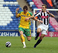 Photo: Mark Stephenson.<br /> West Bromwich Albion v Norwich City. Coca Cola Championship. 27/10/2007.Norwich's Michael Spillane on the ball from Carl Hoefkens