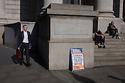 "Businessmen walk near David Cameron's Conservative party's election promise on Evening Standard headline in the City of London. David Cameron has said his aim is to guarantee a ""good life"" for British workers and families as he launched the Conservatives' election manifesto. The prime minister said he wanted ""to finish the job"" of rebuilding Britain on behalf of ""working people"". Labour said the Conservatives were the ""party of the richest in society""."