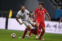 """Joe Allen, right, of Wales national football team kicks the ball to make a pass against Nahitan Nandez of Uruguay national football team in their final match during the 2018 Gree China Cup International Football Championship in Nanning city, south China's Guangxi Zhuang Autonomous Region, 26 March 2018.<br /> <br /> Edinson Cavani's goal in the second half helped Uruguay beat Wales to claim the title of the second edition of China Cup International Football Championship here on Monday (26 March 2018). """"It was a tough match. I'm very satisfied with the result and I think that we can even get better if we didn't suffer from jet lag or injuries. I think the result was very satisfactory,"""" said Uruguay coach Oscar Tabarez. Wales were buoyed by a 6-0 victory over China while Uruguay were fresh from a 2-0 win over the Czech Republic. Uruguay almost took a dream start just 3 minutes into the game as Luis Suarez's shot on Nahitan Nandez cross smacked the upright. Uruguay were dealt a blow on 8 minutes when Jose Gimenez was injured in a challenge and was replaced by Sebastian Coates. Inter Milan's midfielder Matias Vecino of Uruguay also fired at the edge of box from a looped pass but only saw his attempt whistle past the post. Suarez squandered a golden opportunity on 32 minutes when Ashley Williams's wayward backpass sent him clear, but the Barca hitman rattled the woodwork again with goalkeeper Wayne Hennessey well beaten."""