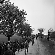 German prisoners of war marching along a  road. 1945