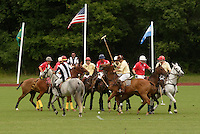 Town of Wallkill, NY - An umpire, in striped shirt at left, bowls the ball at the start of a polo match at the Blue Sky Polo Club on Aug. 19, 2007.