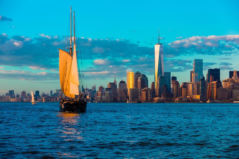 Sailing ship with Lower Manhattan behind, New York, New York USA.