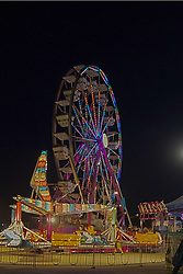 07 August 2015:   McLean County Fair - sizzler, ferris wheel<br /> <br /> This image was produced in part utilizing High Dynamic Range (HDR) processes.  It should not be used editorially without being listed as an illustration or with a disclaimer.  It may or may not be an accurate representation of the scene as originally photographed and the finished image is the creation of the photographer.